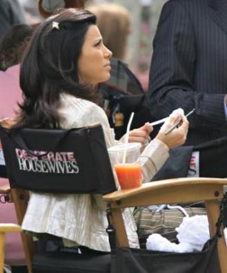 """14070, PASADENA, CALIFORNIA, Monday, February 26, 2007, Actress Eva Longoria relaxes in between takes of her hit TV show """"Desperate Housewives"""". Eva passed the time by knitting, eating, and cuddling her white dog. At one point, she applied her own make-up while holding a mirror. Photograph: Andrew Shawaf, Pacificcoastnews.com ***FEE MUST BE AGREED PRIOR TO USAGE *** UK: +44 131 225 3333/3322 USA: +1 310 261 9676"""